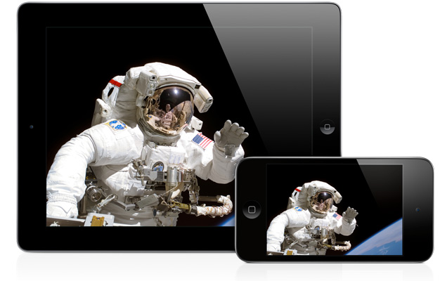 Photo of an astronaut out for a spacewalk, shown on an iPad and an iPod touch